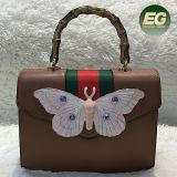 蝶は女性ハンド・バッグのヨーロッパ様式の女性のショルダー・バッグのレトロのハンドルSh193を飾った
