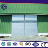 Автоматическая секционная надземная дверь для промышленной мастерской