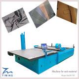 Tela de materia textil y cortadora autos del paño