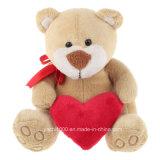 Oso de la felpa del regalo de la tarjeta del día de San Valentín con el corazón rojo