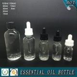 Bouteille en verre transparente d'huile essentielle avec le chapeau de compte-gouttes