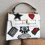 中国の工場Sy8674から飾られる有名なブランドの女性袋の高品質PUの女性のハンドバッグの漫画