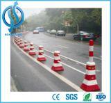 Barreira vermelha e branca da estrada da construção