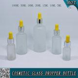 Cosmético que empacota o frasco do conta-gotas do petróleo essencial de vidro geado