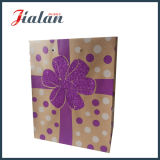 ブラウンクラフト紙の印刷されたきらめきの花のショッピングギフトの紙袋