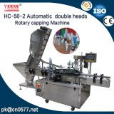Máquina que capsula rotatoria de los casquillos plásticos dobles de las pistas para la bebida (HC-50-2)