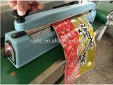 Máquina manual da selagem de impulso com corpo e o cortador de alumínio