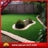 La hierba artificial alfombra el césped para el estadio de fútbol y la hierba natural para las pavimentadoras de la hierba del jardín