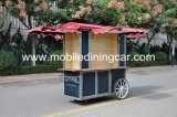 Main de cru poussant la vente chaude de chariot de nourriture