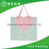 Achats bon marché réutilisés de cadeau estampés par coutume empaquetant le fournisseur de sac de papier d'emballage avec le traitement