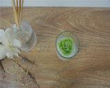 A vela de vidro do copo com a cera natural da soja