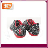 Chaussures noires du football d'intérieur de couleur à vendre