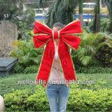 Arco gigante del velluto rosso della decorazione di natale