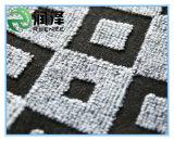 El doble colorea la alfombra del telar jacquar