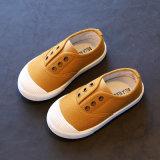熱い販売キャンデーは1から6歳の男女兼用の子供のズック靴の幼稚園の平らな靴を着色する