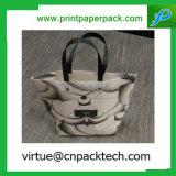 La laminación de lujo en blanco y negro de regalo de cosméticos bolsa de papel con asa retorcida