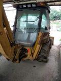 Caricatore usato dell'escavatore a cucchiaia rovescia della cassa 580L del caricatore 580L Orignal S.U.A. dell'escavatore a cucchiaia rovescia di caso
