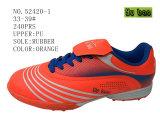 Drie Schoenen van de Jonge geitjes van de Voetbalschoenen van Kleuren