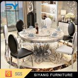 Tableau dinant en verre rond de meubles à la maison pour le mariage