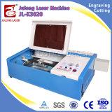 Portátil Julong grabadora láser CO2, grabador con la bomba de agua bomba de aire