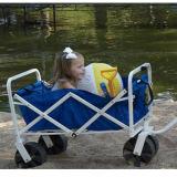شاطئ [كيد/] طفلة يطوي عربة لأنّ خارجيّ يخيّم