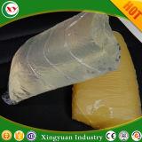 異なった種類のおむつまたは生理用ナプキンの作成のための熱い溶解の接着剤