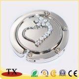 A alta qualidade Diamante-Limitou o gancho do saco do metal e o gancho Foldable do saco com logotipo gravado