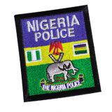 Correção de programa amarela recentemente personalizada do bordado da polícia da cor