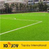 El deporte de hierba artificial de tierra