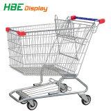 Carrello di acquisto del supermercato con la sede del bambino