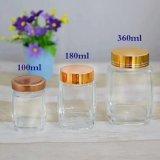Frasco de vidro do armazenamento do mel da forma quadrada com tampa do ouro