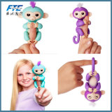 Обезьяна младенца толковейшей игрушки обезьяны Figner Fingerlings взаимодействующая