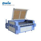 自動挿入の衣服か布または革またはファブリックまたは織物レーザーの打抜き機