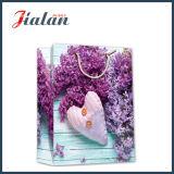 Sac de papier de achat estampé par 4c en gros de cadeau de transporteur de modèle de fleurs