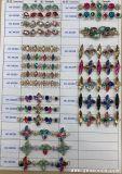 Le guarnizioni in rilievo nuziali di modo degli accessori all'ingrosso dell'indumento cucono sulla catena del Rhinestone