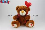 Beige Plüsch angefüllter Teddybär mit rosafarbenem Liebes-Inner-Art-Ballon