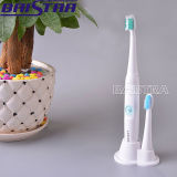 柔らかく、堅いブラシヘッドが付いている電動歯ブラシ