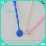 Den Gebrauch aussondern, der zahnmedizinische Mund-Spiegel für zahnmedizinischen Gebrauch mit Spachtel vergrößert