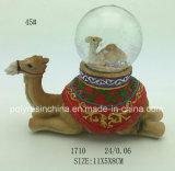 Camelo da resina com globo da neve