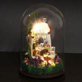 La miniatura de madera contiene el regalo hecho a mano con la educación