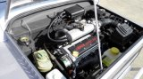 Automobile facente un giro turistico della vettura turistica del motore di benzina