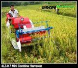 Manuellement déchargement de la petite moissonneuse bon marché de riz en vente