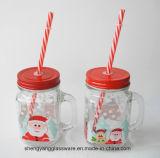La taza de cristal del tarro de /Mason de la taza de la etiqueta con la cubierta de Matel para la Navidad celebra