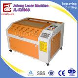 Venta caliente Denim Jeans grabador cortadora y grabadora láser de CO2 40W 50W 60W con una buena calidad