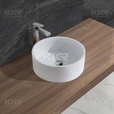 Ovale compteur ci-dessus du bassin en pierre artificielle les lavabos
