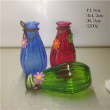 Vaso di vetro con il fiore della piuma