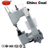 Gk26-1hogar de una bolsa cerca de la máquina de coser