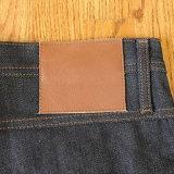 Correção de programa impressa costume do couro gravado para calças de brim