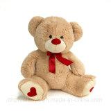 Os brinquedos de pelúcia Teddy Bear com coração e fita para o Dia dos Namorados