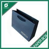 Bolsa de papel azul de lujo con la maneta